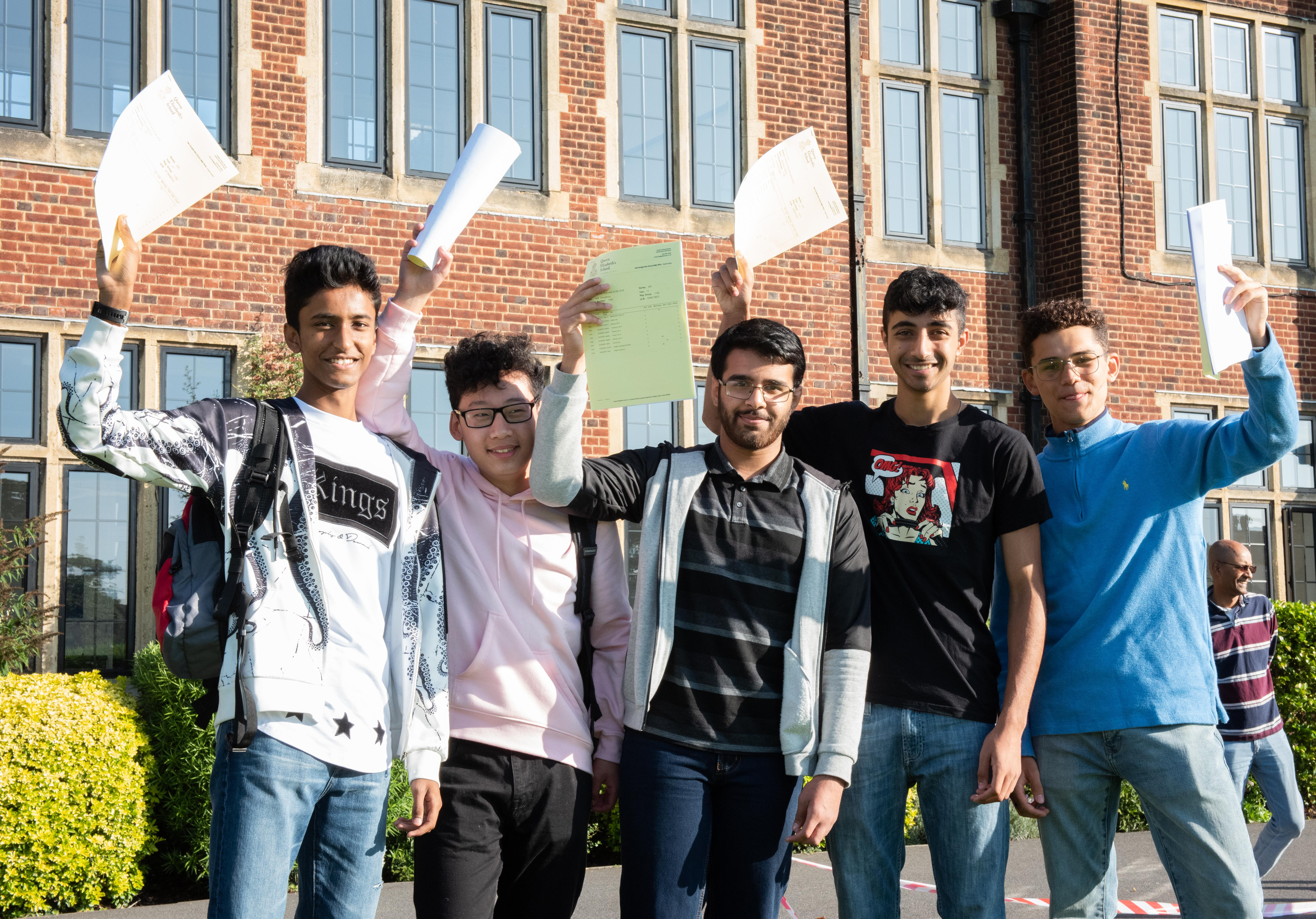 Students across the country are celebrating their GCSE results this week. Pictured are pupils from Queen Elizabeth's School, north London, receiving their record breaking grades.  (Photo credit: Eleanor Bentall)