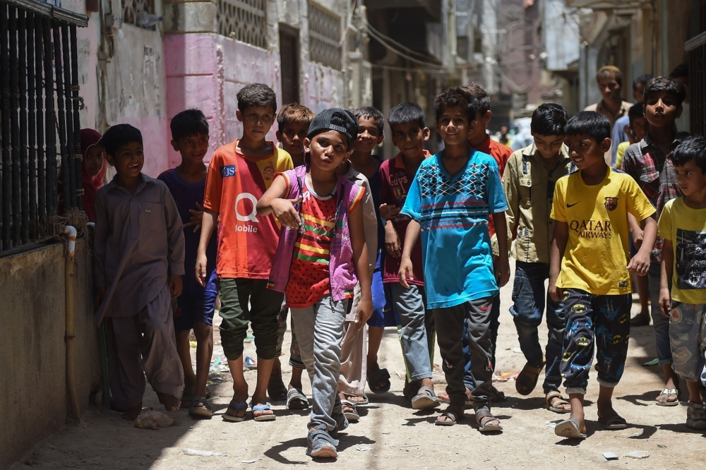 Eight-year-old rapper Waqas Baloch, center, performs in Lyari, one of Pakistan's most dangerous neighborhoods, in Karachi, in this May 19, 2019 file photo. — AFP