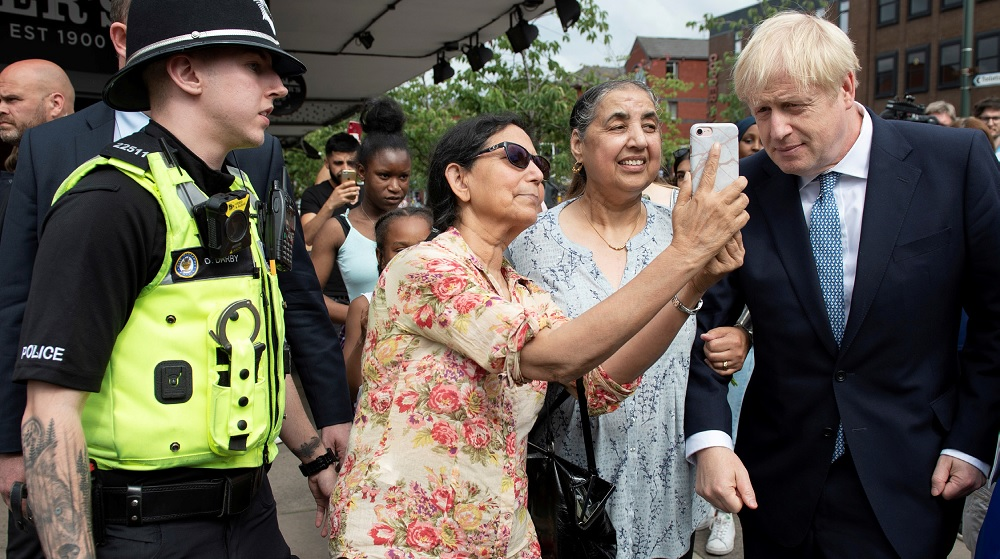 Boris Johnson (right) with Asian supporters in Birmingham.