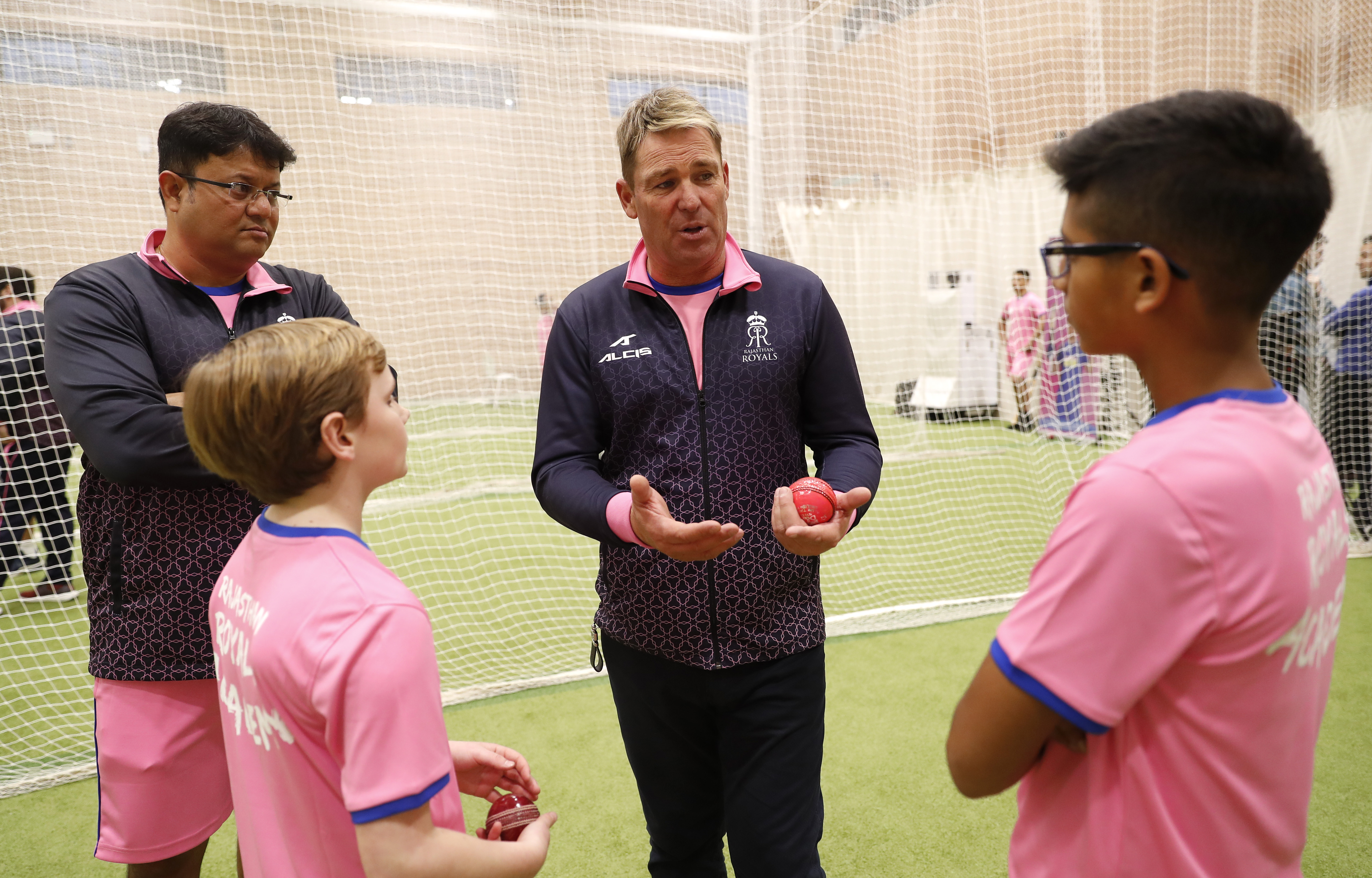 Former Australian and Rajasthan Royals player Shane Warne talks with children from the Rajasthan Royals UK academy on March 18, 2019 in Cobham, England. (Photo by Luke Walker/Getty Images for Rajasthan Royals )