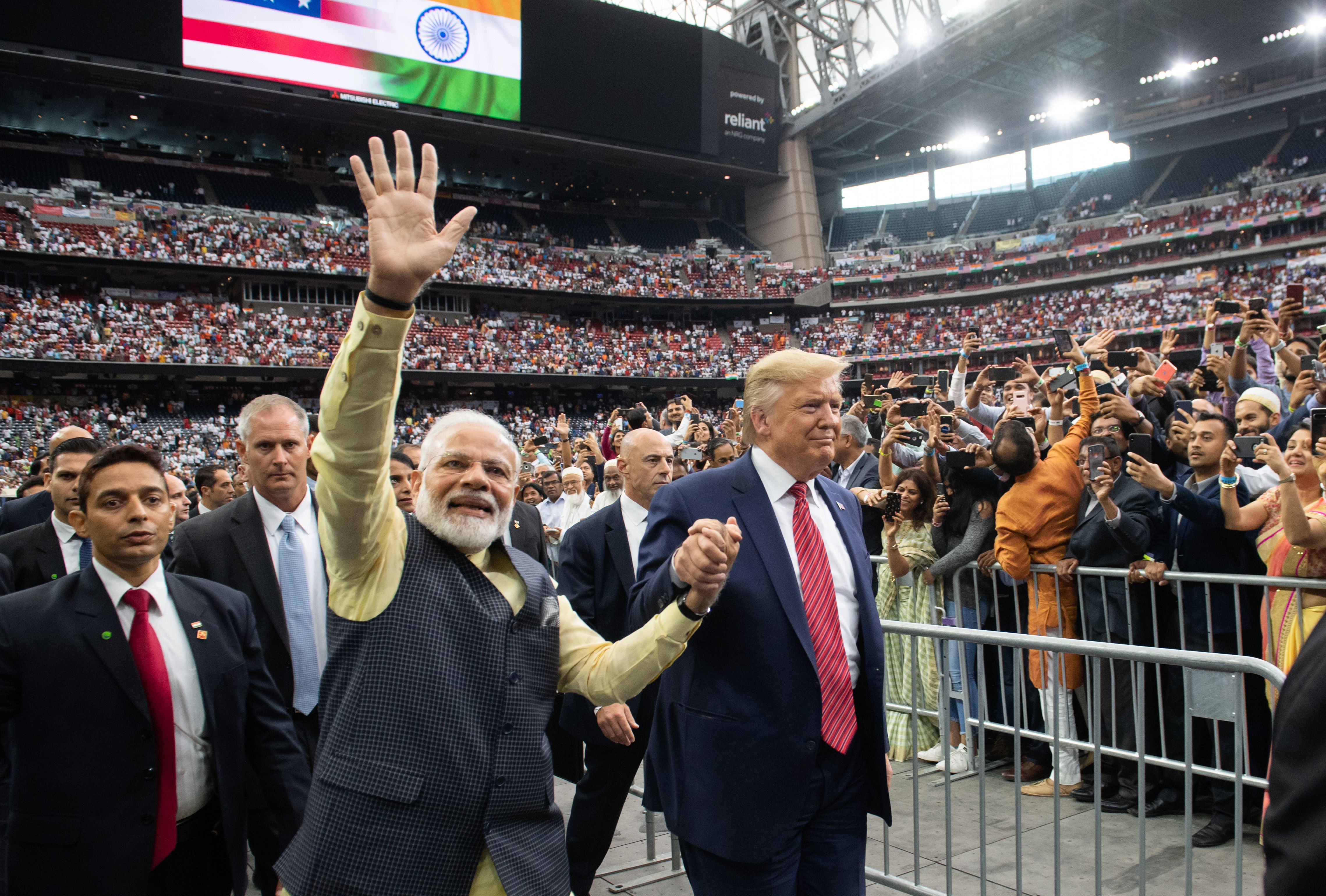 "US President Donald Trump and Indian Prime Minister Narendra Modi attend ""Howdy, Modi!"" at NRG Stadium in Houston, Texas, September 22, 2019. - Tens of thousands of Indian-Americans converged on Houston on Sunday for an unusual joint rally by Donald Trump and Narendra Modi, a visible symbol of the bond between the nationalist-minded leaders. With many in the crowd decked out in formal Indian attire or the signature saffron of Modi's Bharatiya Janata Party, the event kicked off in a football stadium with a Sikh blessing, boisterous bhangra dancing and, in a nod to local customs, cheerleaders in cowboy hats. (Photo by SAUL LOEB / AFP)        (Photo credit should read SAUL LOEB/AFP/Getty Images)"