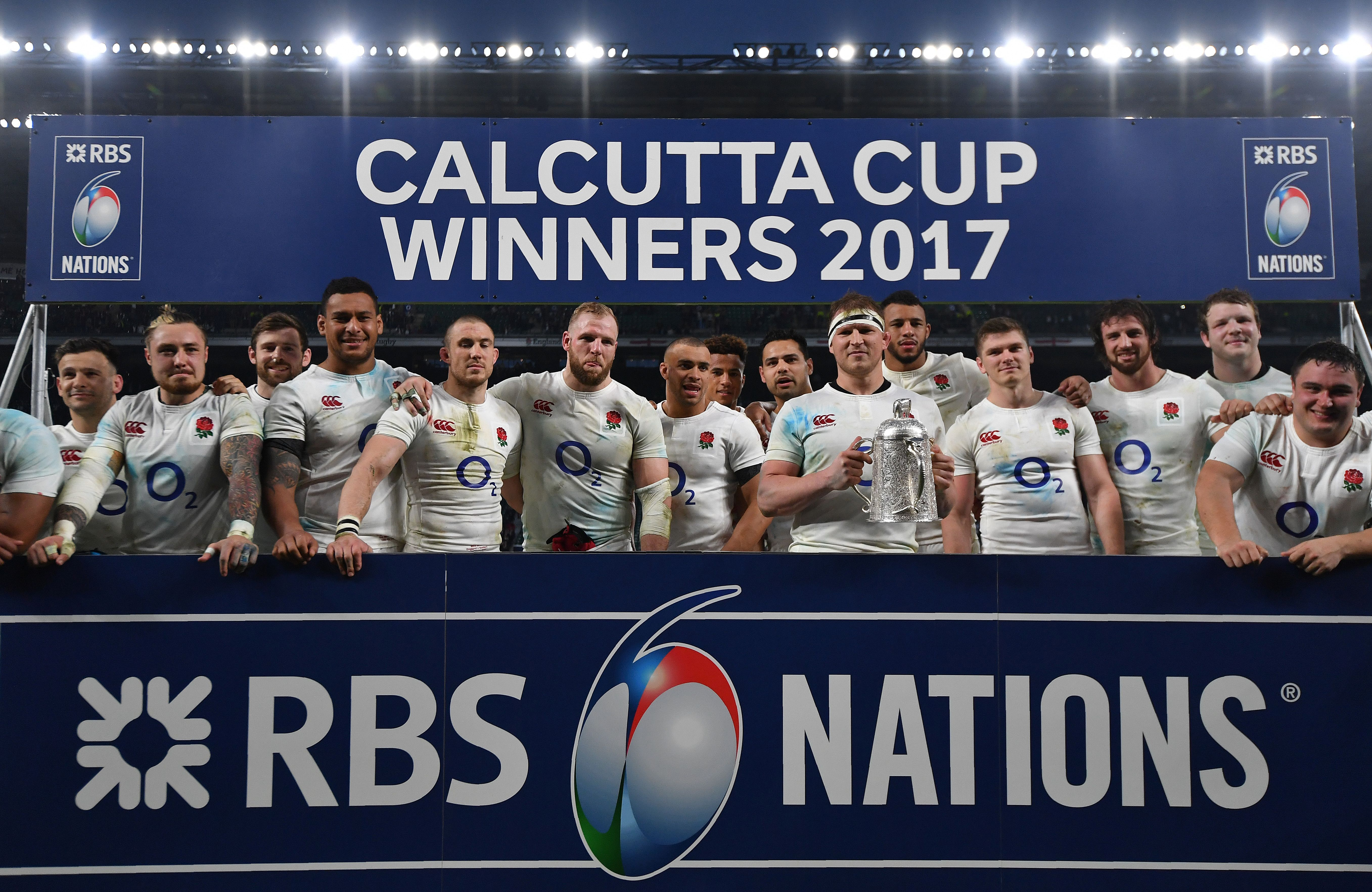 England's hooker and captain Dylan Hartley holds the Calcutta Cup trophy as he poses with teammates atfter winning the Six Nations international rugby union match between England and Scotland at Twickenham stadium in south west London on March 11, 2017. England thrashed Scotland 61-21 at Twickenham on Saturday to win the Six Nations title and equal New Zealand's record of 18 successive Test wins by a 'tier one' nation. / AFP PHOTO / Ben STANSALL        (Photo credit should read BEN STANSALL/AFP/Getty Images)