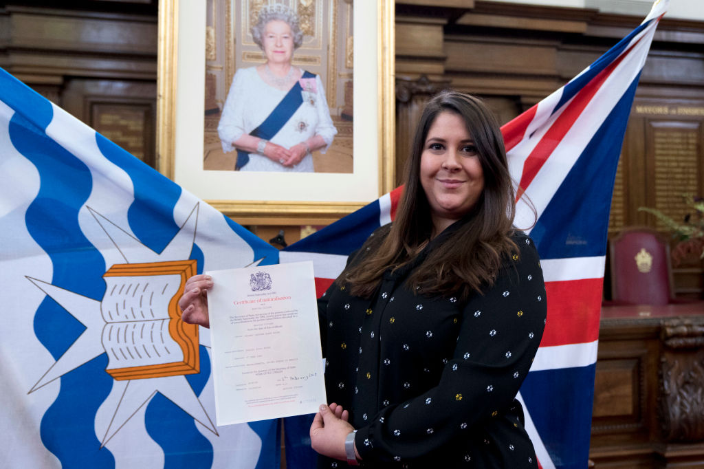New British citizen Laurier Alder with her certificate of naturalisation during a citizenship ceremony at Islington Town Hall, in north London. (Photo: JUSTIN TALLIS/AFP/Getty Images)