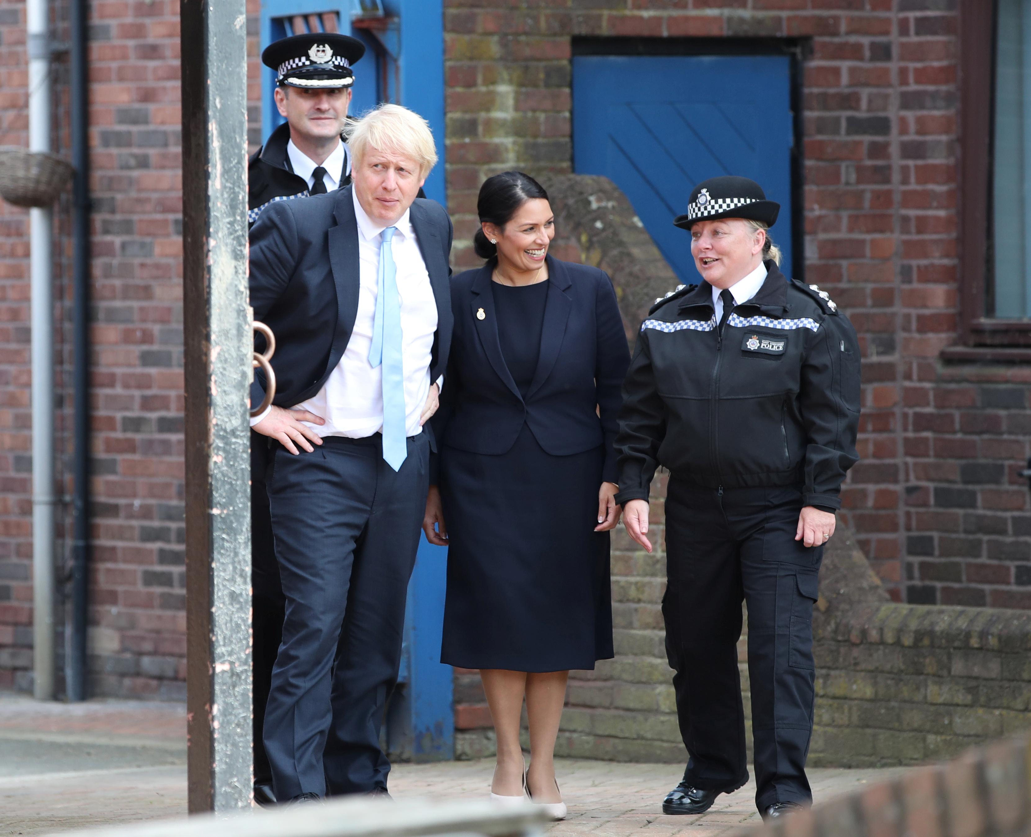 Prime minister Boris Johnson, home secretary Priti Patel, sergeant Annette Twigg and West Yorkshire Police Chief constable John Robins visit West Yorkshire Police Training and Development Centre