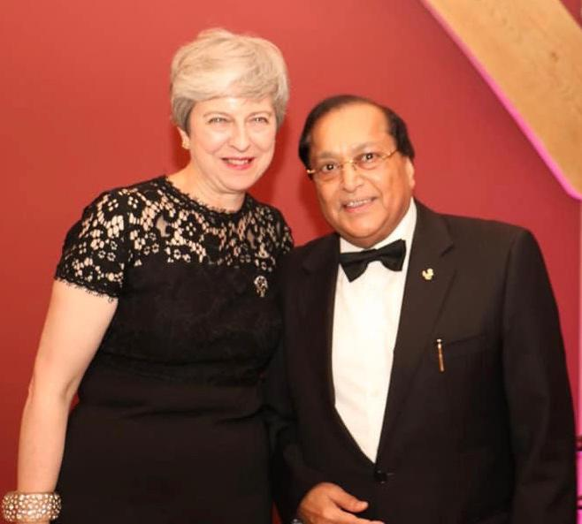 Former prime minister Theresa May with Dr Rami Ranger