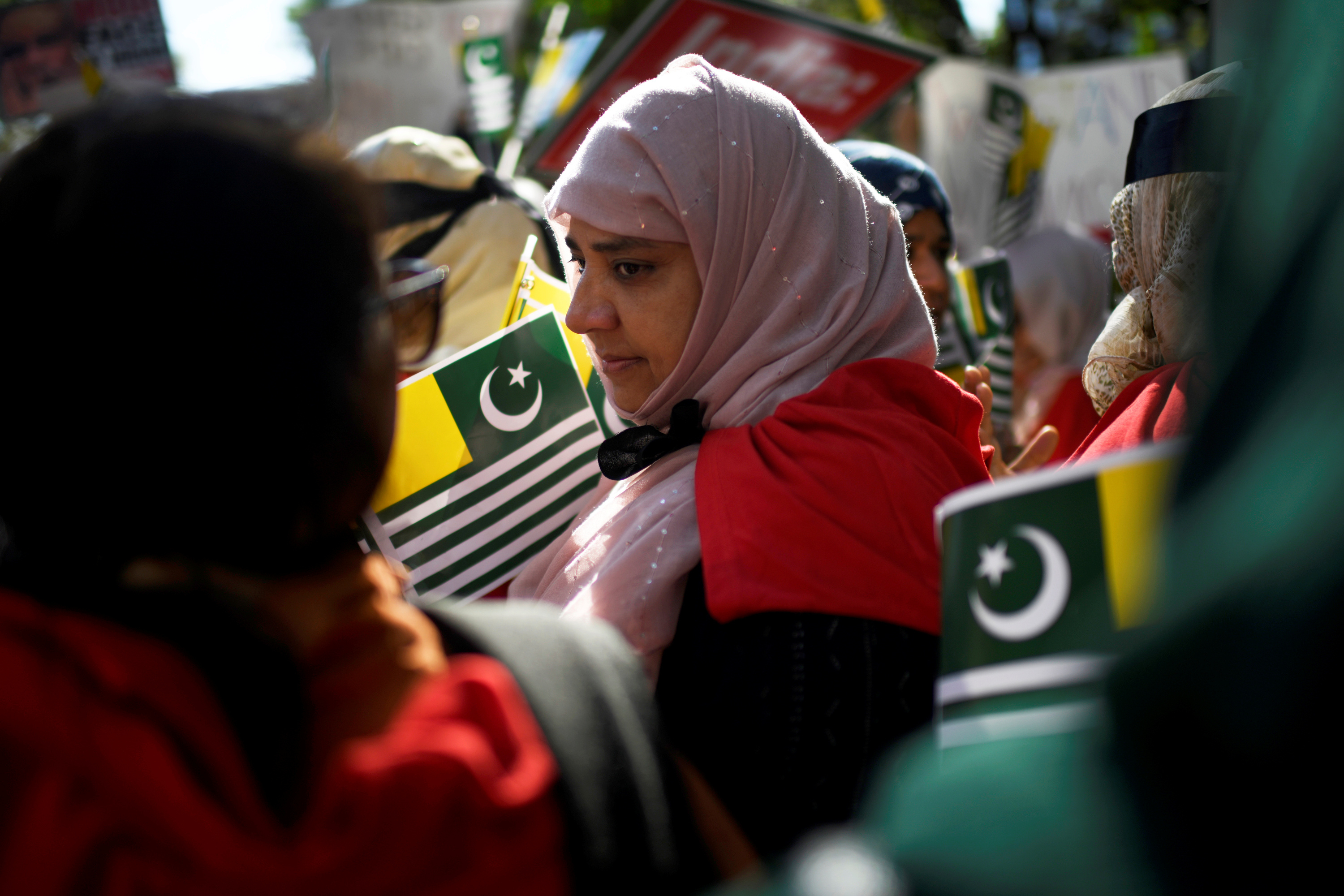 A woman holds a flag of Azad Kashmir at a protest in solidarity with the people of Kashmir. (Photo: REUTERS/Mark Kauzlarich)