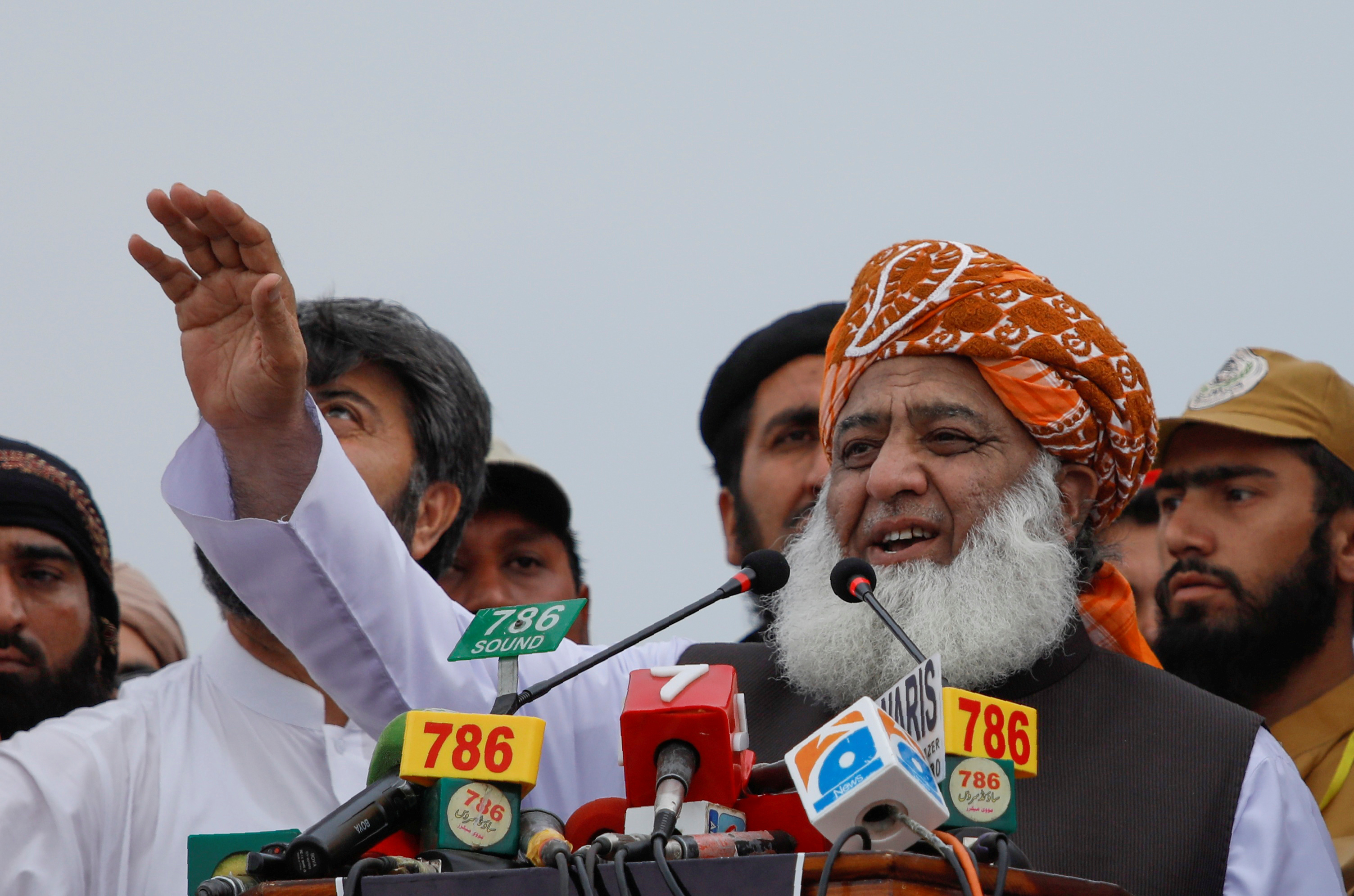 """Fazlur Rehman, President of the Jamiat Ulema-e-Islam (JUI), speaks to the supporters during a countrywide protest called """"Black Day"""" against the government of prime minister Imran Khan, in Peshawar, Pakistan July 25, 2019. REUTERS/Fayaz Aziz - RC1BF67675A0/File Photo"""