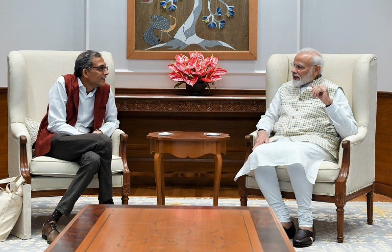Abhijit Banerjee, one of the three winners of the 2019 Nobel Prize in Economics, speaks with India's prime minister Narendra Modi during their meeting in New Delhi, India, October 22, 2019 (India's Press Information Bureau/Handout via REUTERS).