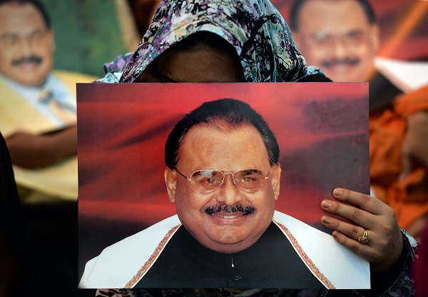 Supporters of Pakistan's Muttahida Qaumi Movement (MQM) party hold photographs of party leader Altaf Hussain as they stage a sit-in calling for his release in Karachi on June 3, 2014 (Photo: ASIF HASSAN/AFP/Getty Images).