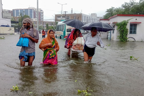 Patients wade through floodwaters on their way to hospital during heavy monsoon rain in Patna in the northeastern state of Bihar on September 28, 2019 (Photo: SACHIN KUMAR/AFP/Getty Images).