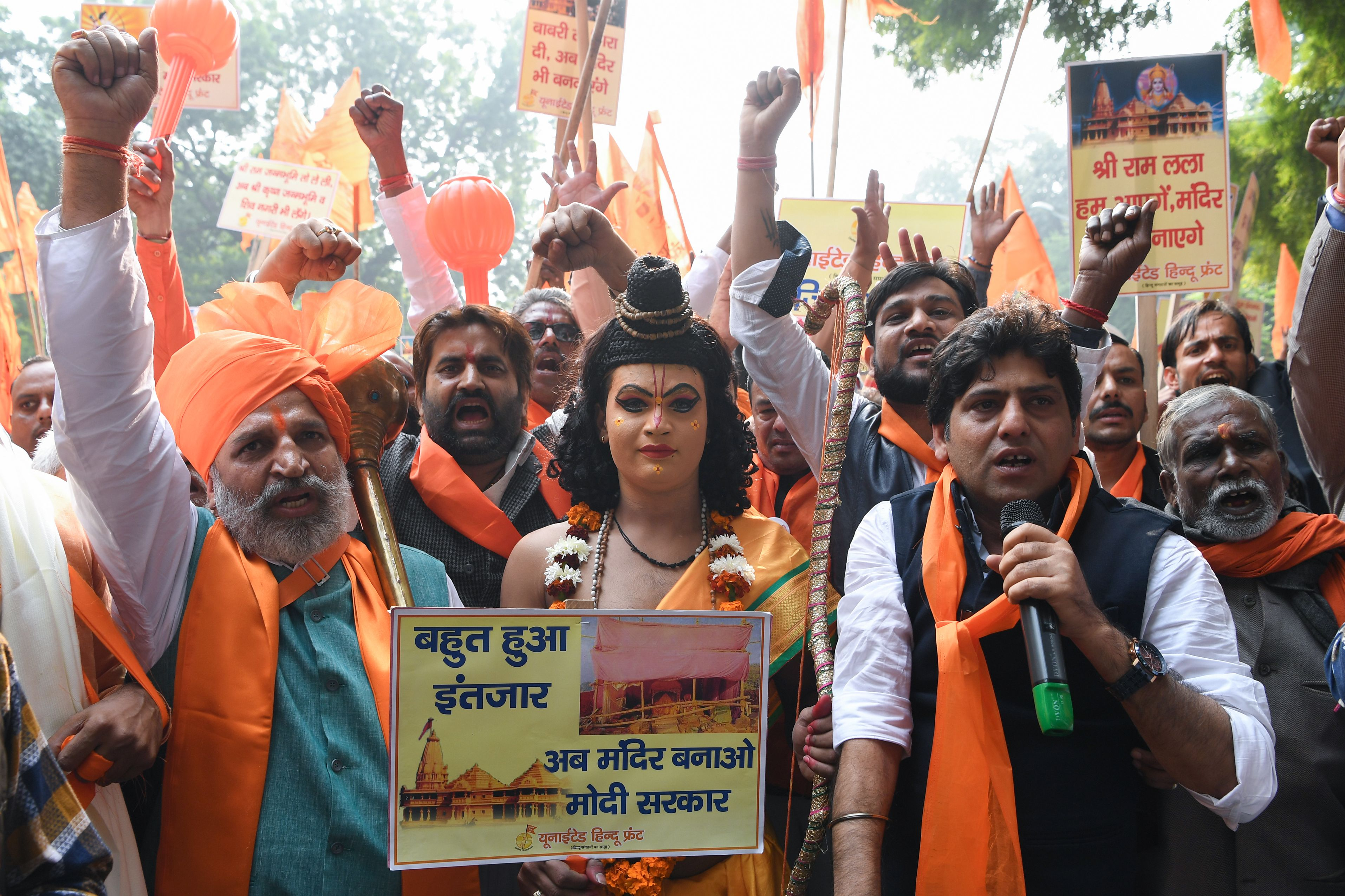 Activists of the right-wing United Hindu Front shout slogans during a demonstration calling for the construction of a temple on the site of the demolished 16th century Babri mosque located in Ayodhya which sparked rioting that killed thousands, during the 26th anniversary of the incident in New Delhi on December 6, 2018. (SAJJAD HUSSAIN/AFP/Getty Images)