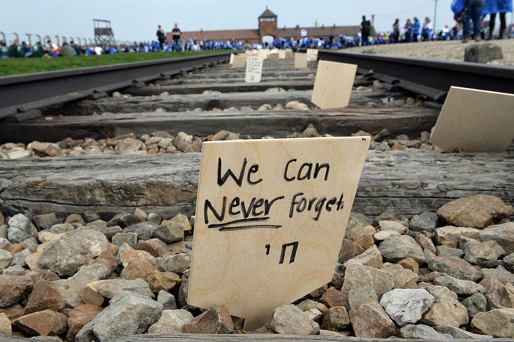 A sign is seen on the tracks at the former Nazi German Auschwitz-Birkenau death camp  (Photo: JANEK SKARZYNSKI/AFP/Getty Images)