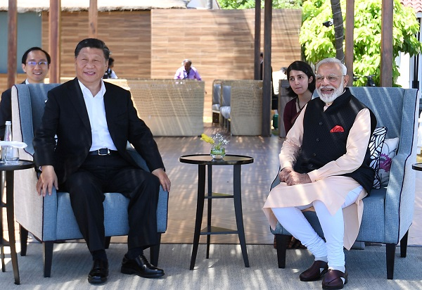 India's prime minister Narendra Modi and China's president Xi Jinping look on during their meeting in Mamallapuram on the outskirts of Chennai, India, October 12, 2019 (India's Press Information Bureau/Handout via REUTERS).
