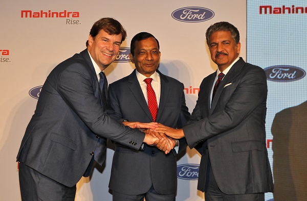 Jim Farley, President of Ford New Businesses, Technology & Strategy, Pawan Goenka, Managing Director of Mahindra & Mahindra Limited, and Anand Mahindra, Chairman of Mahindra Group, join their hands after attending a news conference in Mumbai, India, October 1, 2019 (REUTERS/Prashant Waydande).