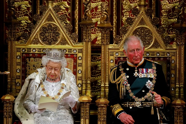 Britain's Queen Elizabeth delivers the Queen's Speech during the State Opening of Parliament, next to Charles, Prince of Wales in the House of Lords at the Palace of Westminster in London, Britain October 14, 2019 (Tolga Akmen/Pool via REUTERS).