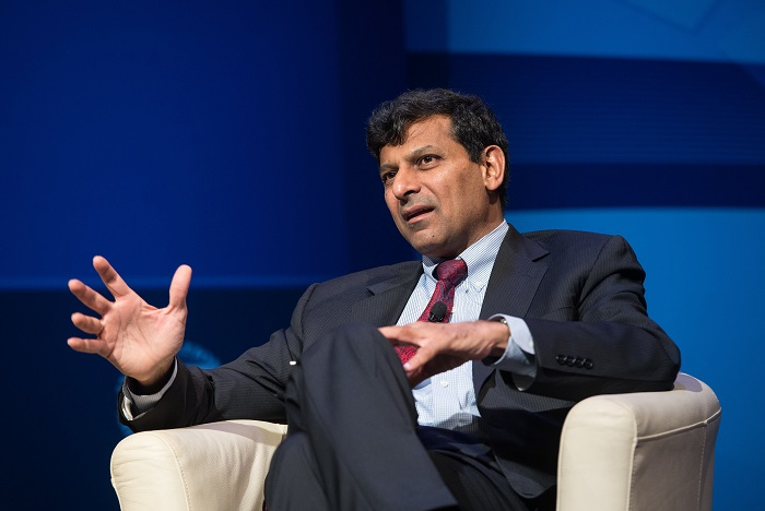 """Addressing a packed gathering of the National Indian Students and Alumni Union UK (NISAU) in London last Wednesday (23) Raghuram Rajan said: """"Let's strengthen our democracy- that is something Gandhi would very much believe in."""" (Photo: NICHOLAS KAMM/AFP via Getty Images)."""