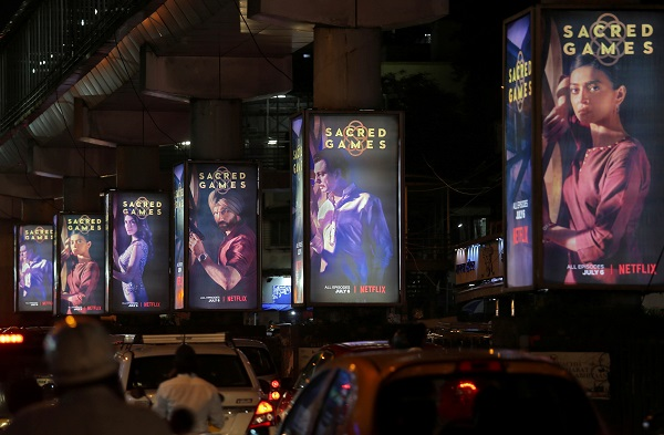 Traffic moves on a road past hoardings of Netflix's new television series 'Sacred Games' in Mumbai, India, July 11, 2018 (REUTERS/Francis Mascarenhas/File Photo).