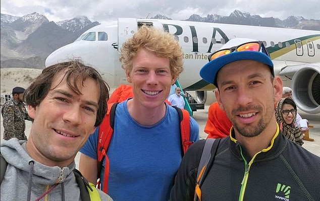 Tom Livingstone (centre) and John Crook (right) were among the climbers rescued. (Facebook)