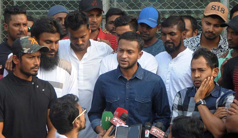 Bangladesh national cricket team captain Shakib Al Hasan (centre) speaks to the media, along with teammate Mushfiqur Rahim (right) at the Sher-e-Bangla National Stadium, in Dhaka | AFP