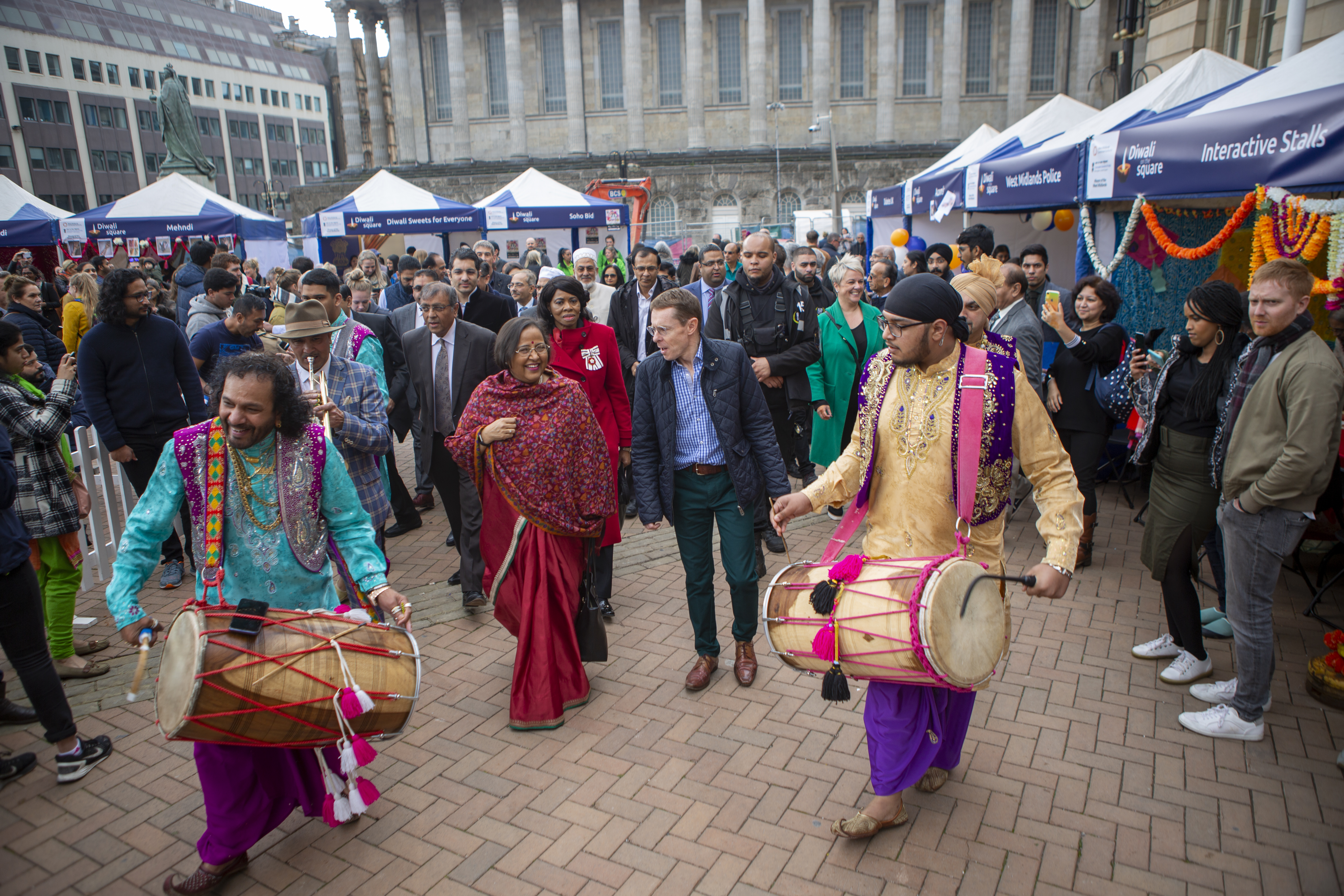 File photo: Outgoing high commissioner of India to UK, Ruchi Ghanashyam, and Mayor Andy  Street at Victoria Square, Birmingham, being escorted by 'Dhol' performers.