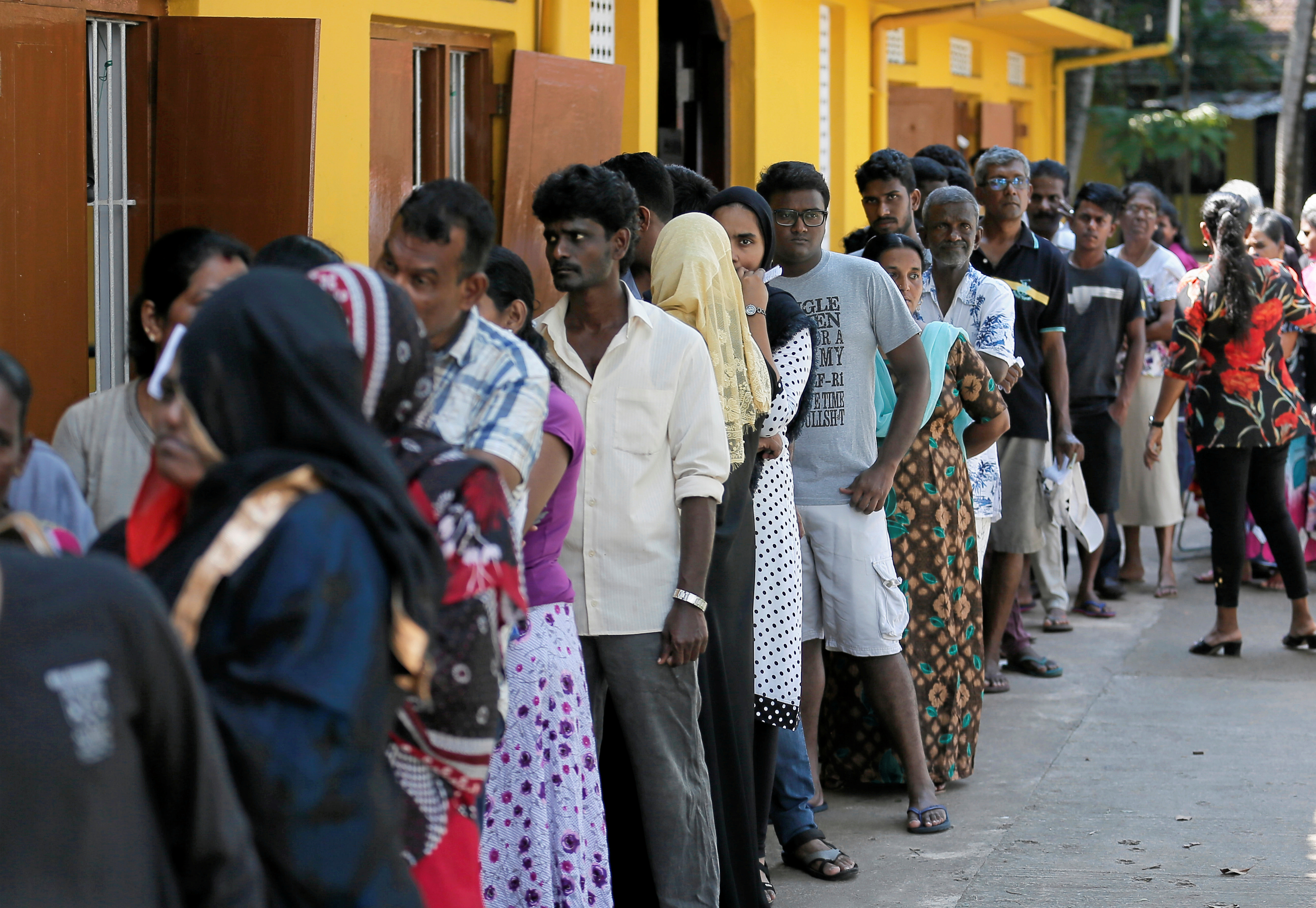 People stand in a line to cast their vote during the presidential election in Colombo, Sri Lanka November 16, 2019. REUTERS/Dinuka Liyanawatte