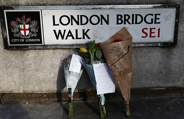 Flowers are left at the scene of a stabbing on London Bridge, in which two people were killed, in London, Britain, November 30, 2019. REUTERS/Simon Dawson