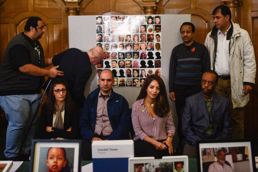 Survivors and family members of people involved in the Grenfell fire, (L-R) Nabil Choucair, El Alami Hamdan, Flora Neda, Hamid Al Jafari, Nazanin Aghlani, Shemsu Kedir, Paulos Tekle and Shah Aghlani pose for a photograph following a press conference on October 30, 2019 in London, England.  (Photo by Peter Summers/Getty Images)