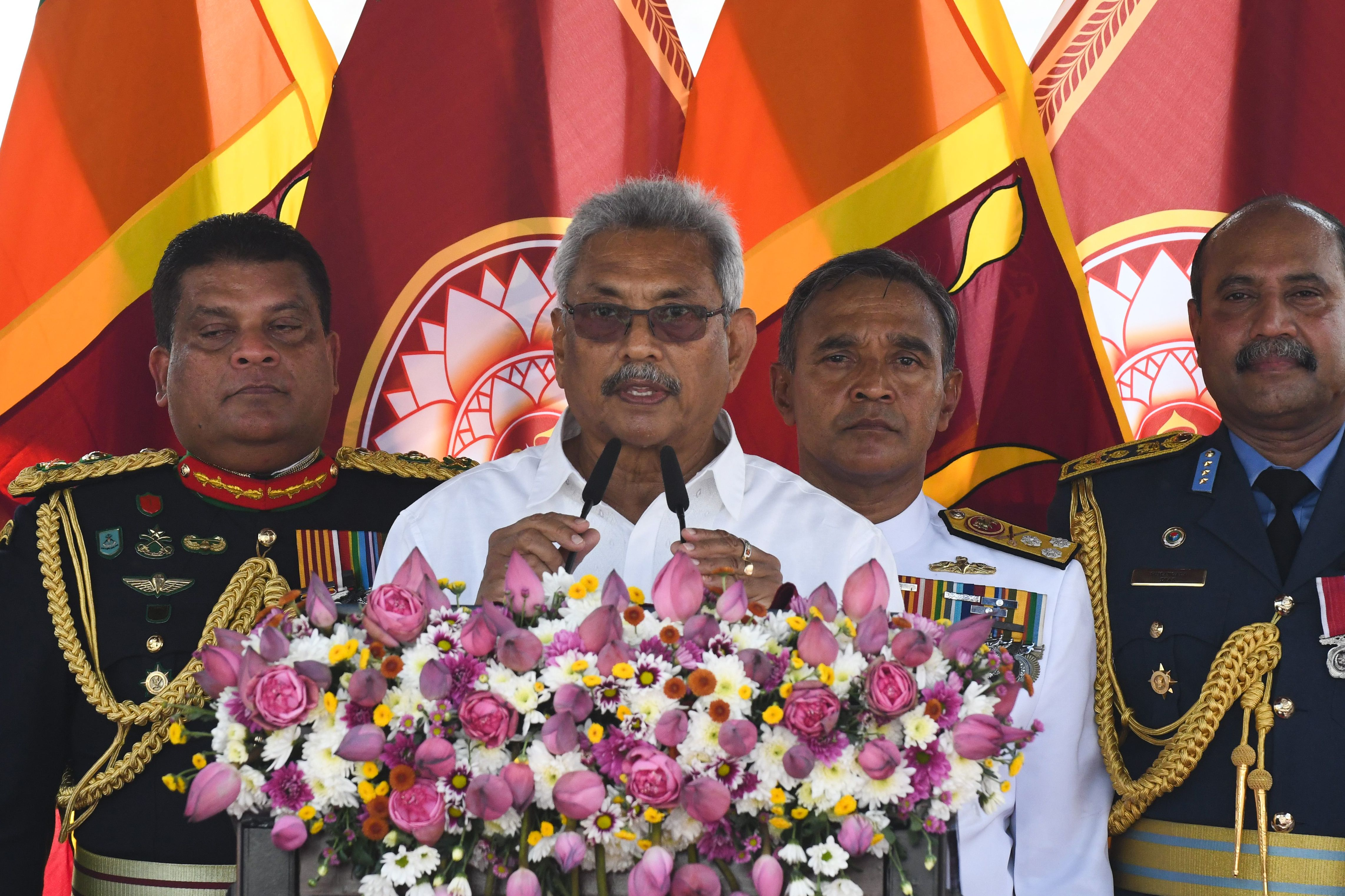 Sri Lanka's president Gotabaya Rajapaksa (C) speaks during his swearing-in ceremony at the Ruwanwelisaya temple in Anuradhapura on November 18, 2019.  (Photo by LAKRUWAN WANNIARACHCHI/AFP via Getty Images)