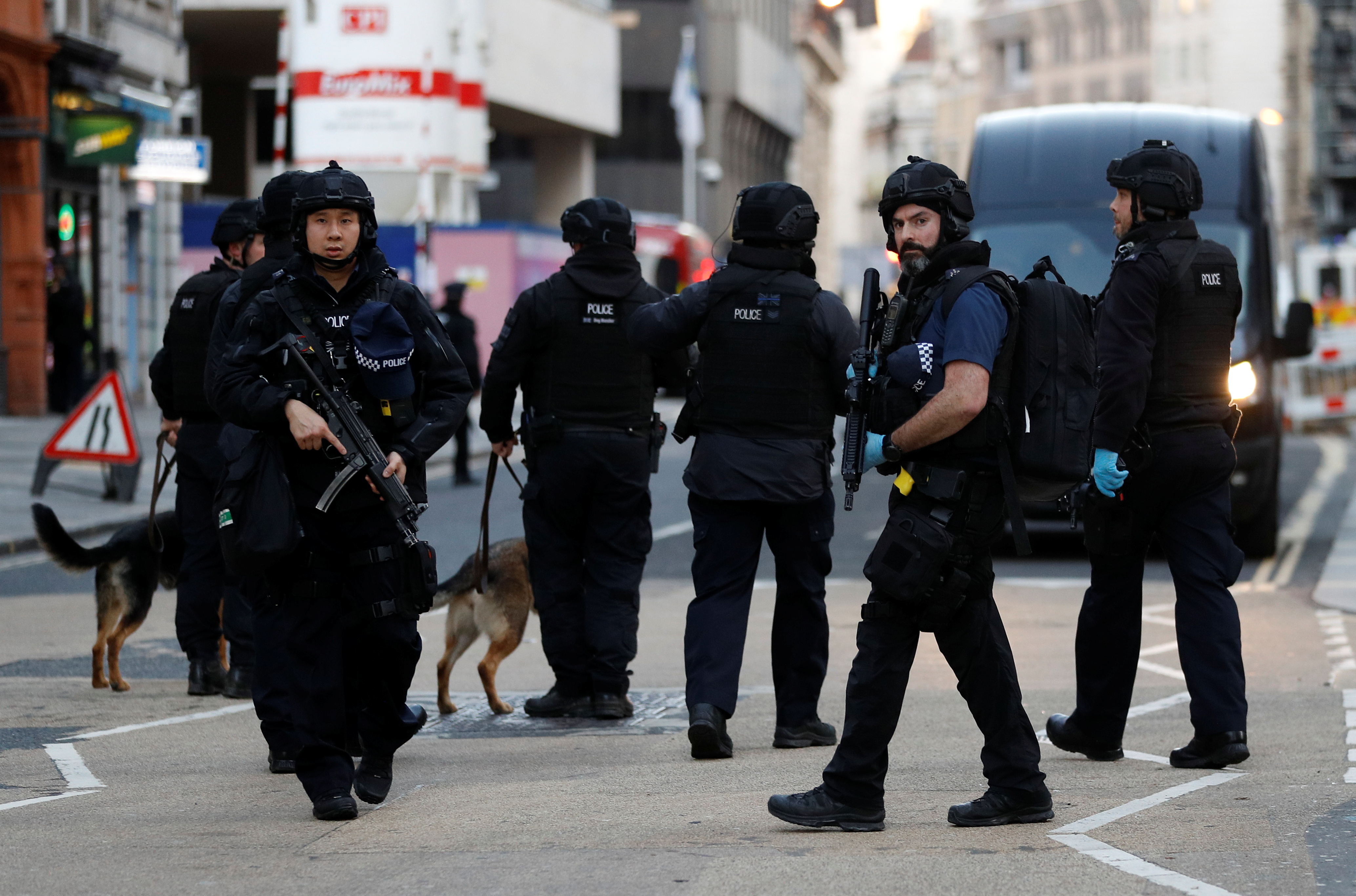 Police officers are seen near the site of an incident at London Bridge