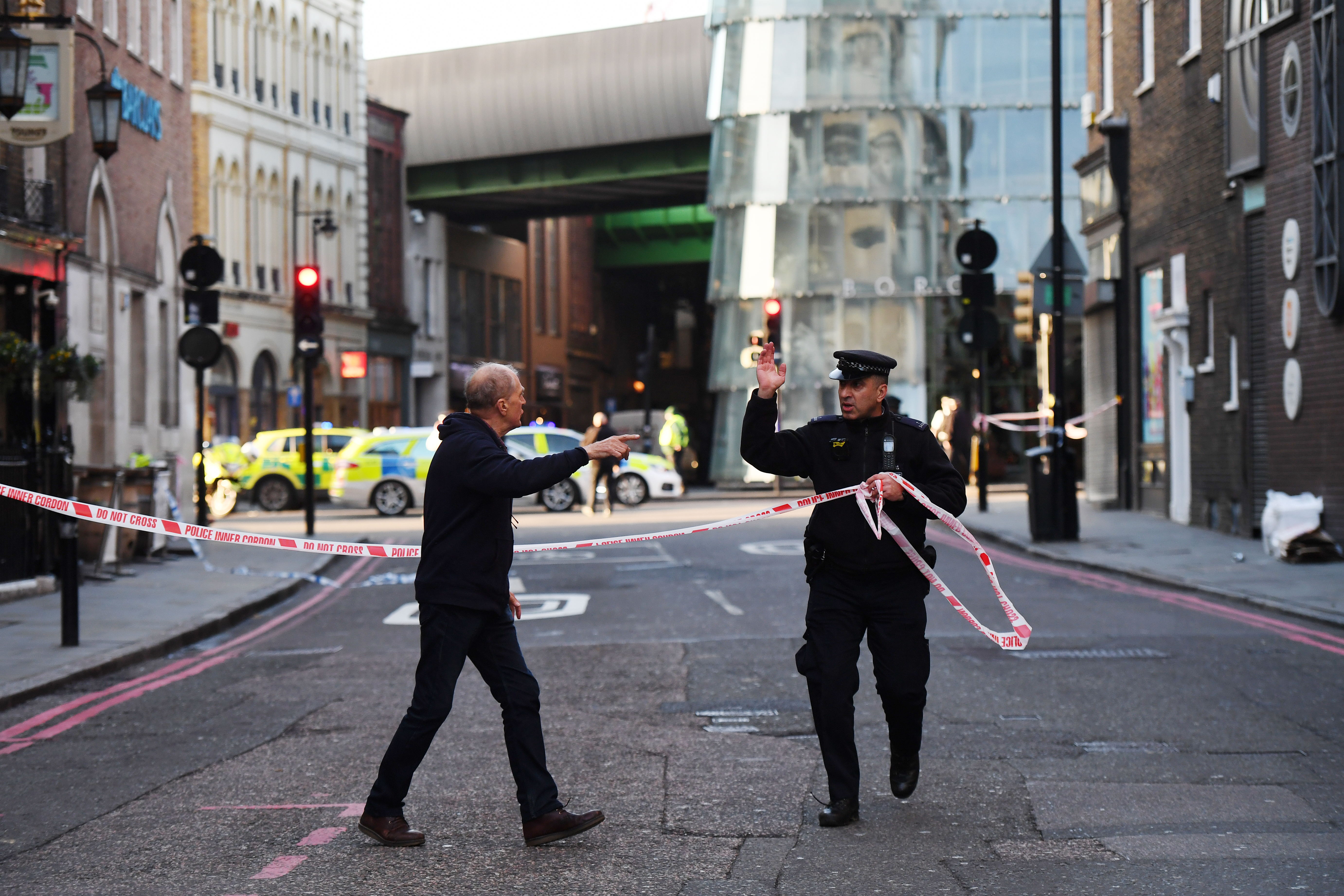 Members of the public are held behind a police cordon near London Bridge train station after reports of shots being fired on London Bridge on November 29 in London. (Chris J Ratcliffe/Getty Images)
