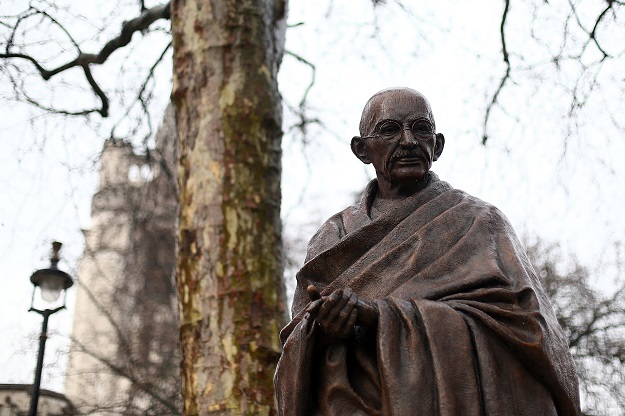 Those who attacked Gandhi, arguably the greatest human being of the 20th century, should also by the same logic desecrate the monuments of Nelson Mandela and Martin Luther King Jnr, because they proudly proclaimed they were his followers and inspired by his example (Photo: Carl Court/Getty Images).