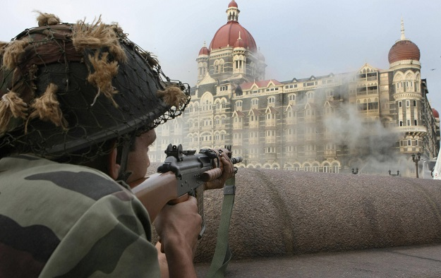 An Indian army soldier holds positions outside The Taj Mahal hotel in Mumbai on November 29, 2008 (Photo: SAJJAD HUSSAIN/AFP via Getty Images).
