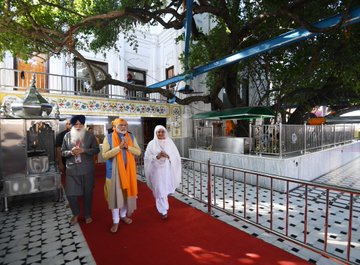 """The opening has even inspired a singular message of gratitude from Indian prime minister Narendra Modi to his Pakistani counterpart Imran Khan for """"respecting the sentiments of India"""". Khan greeted pilgrims at the shrine, and in televised images could be seen speaking with Manmohan Singh (Photo: @narendramodi/ Twitter)."""