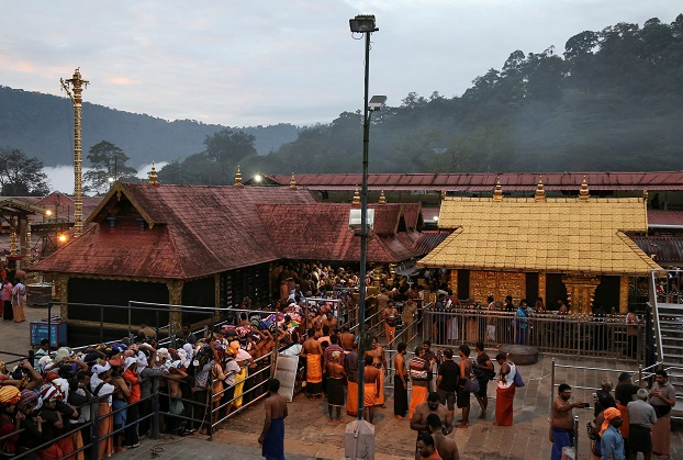 Hindu devotees wait in queues inside the premises of the Sabarimala temple in Pathanamthitta district in the southern state of Kerala, India (REUTERS/Sivaram V/File Photo).