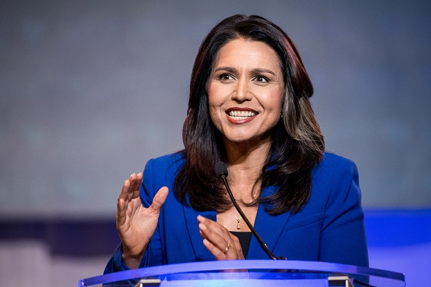 COLUMBIA, SC - JUNE 22: Democratic presidential candidate Rep. Tulsi Gabbard (R-HI) addresses the crowd during the 2019 South Carolina Democratic Party State Convention on June 22, 2019 in Columbia, South Carolina. Democratic presidential hopefuls are converging on South Carolina this weekend for a host of events where the candidates can directly address an important voting bloc in the Democratic primary. (Photo by Sean Rayford/Getty Images)