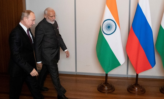 FILE PHOTO: Russian president Vladimir Putin and Indian prime minister Narendra Modi arrive for their talks on the sideline of the 11th edition of the BRICS Summit, in Brasilia, Brazil November 13, 2019 (Pavel Golovkin/Pool via REUTERS).