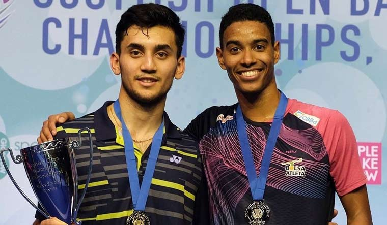 Lakshya Sen (left) and his Brazilian opponent Ygor Coelho with their medals and trophies | via Twitter