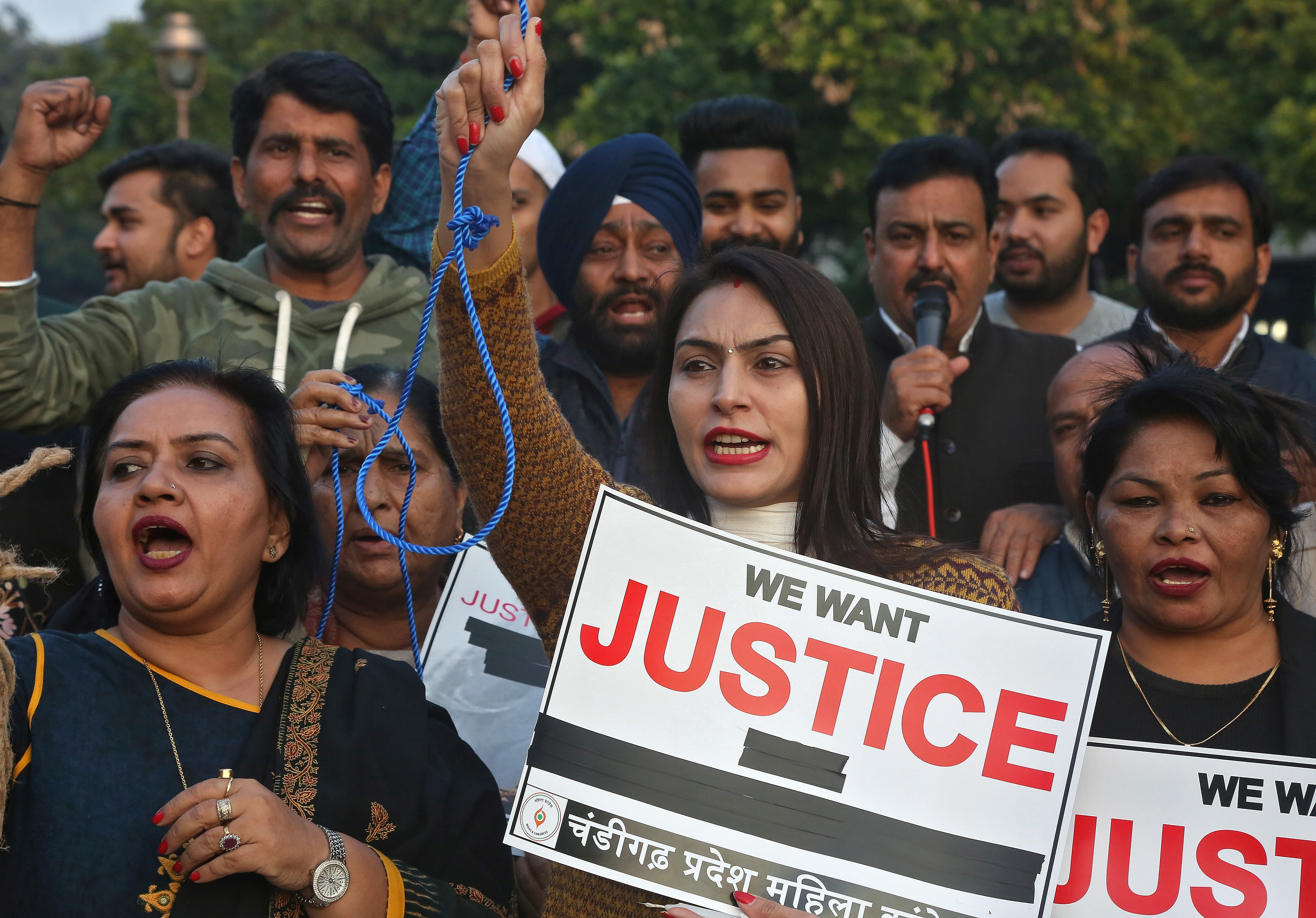 People shout slogans during a protest against the alleged rape and murder of a 27-year-old woman, in Chandigarh, India, December 2, 2019. REUTERS/Ajay Verma