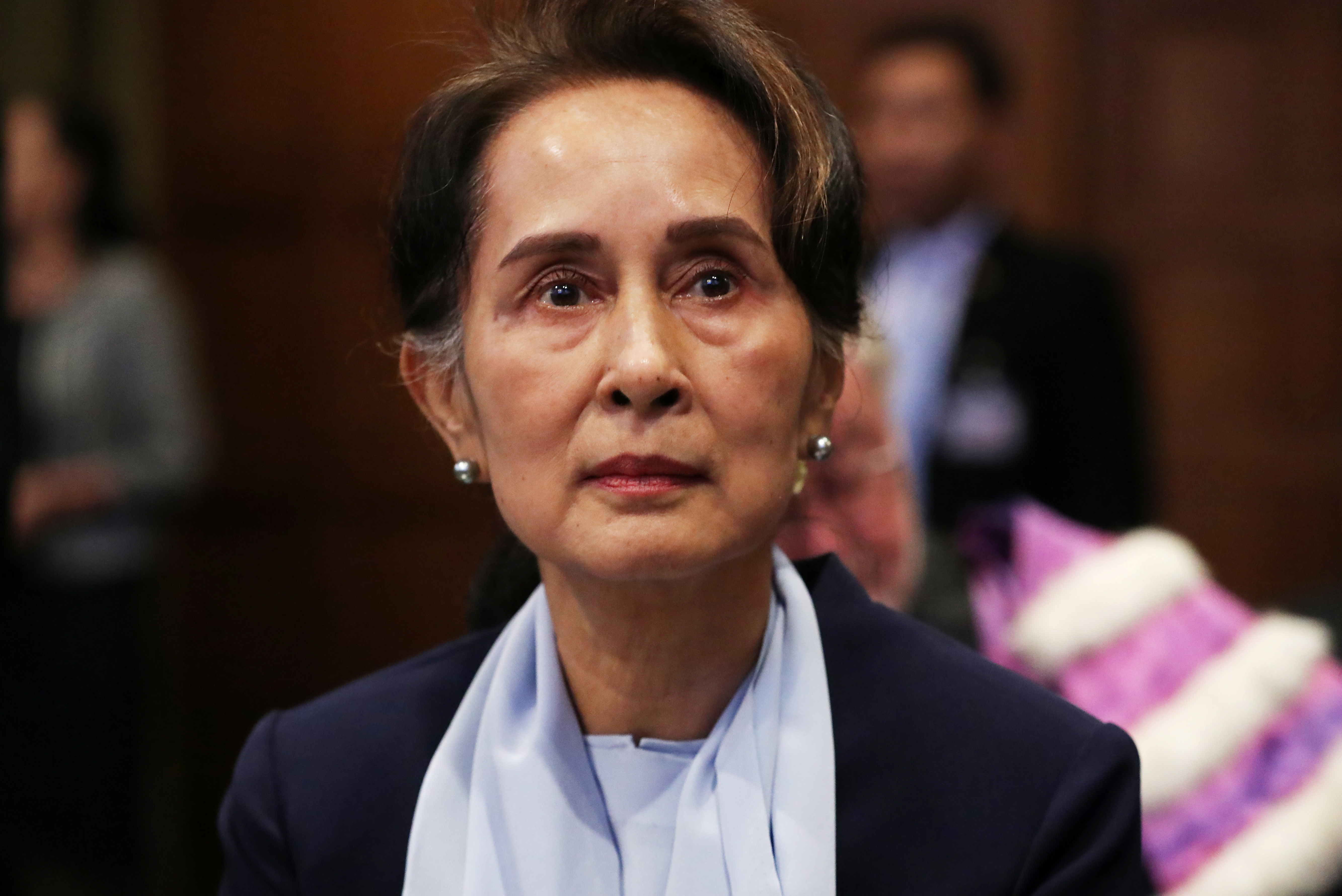 FILE PHOTO: Myanmar's leader Aung San Suu Kyi arrives at the International Court of Justice (ICJ) for the second day of hearings in a case filed by Gambia against Myanmar alleging genocide against the minority Muslim Rohingya population, in The Hague, Netherlands December 11, 2019.  REUTERS/Yves Herman