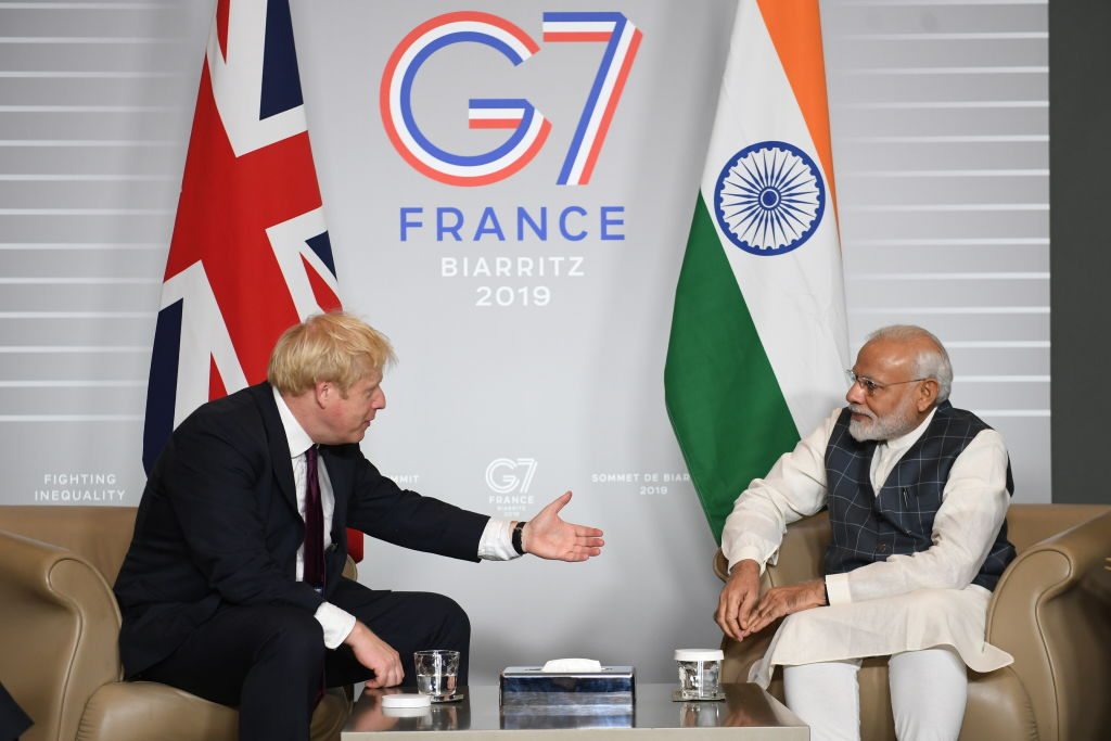 British prime minister Boris Johnson (L) with prime minister of India Narendra Modi  (Photo by Stefan Rousseau - Pool/Getty Images)