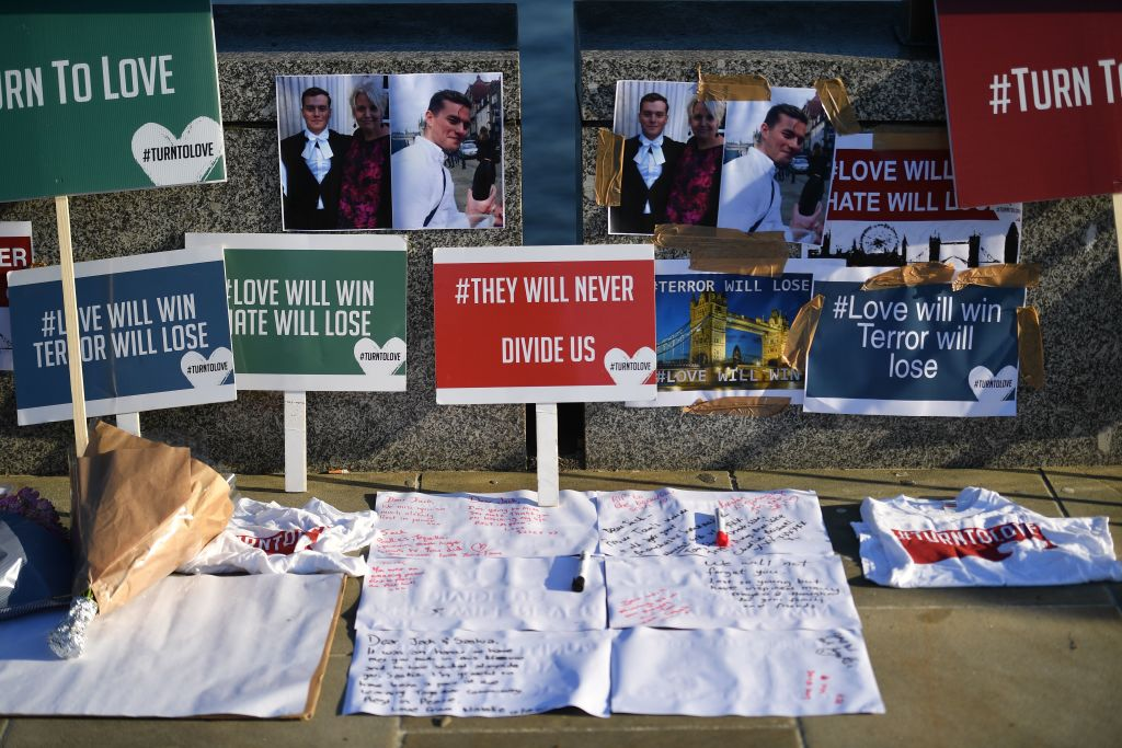 Banners and pictures are placed on London Bridge in memory of the victims of London Bridge attack. (Photo by DANIEL LEAL-OLIVAS/AFP via Getty Images)