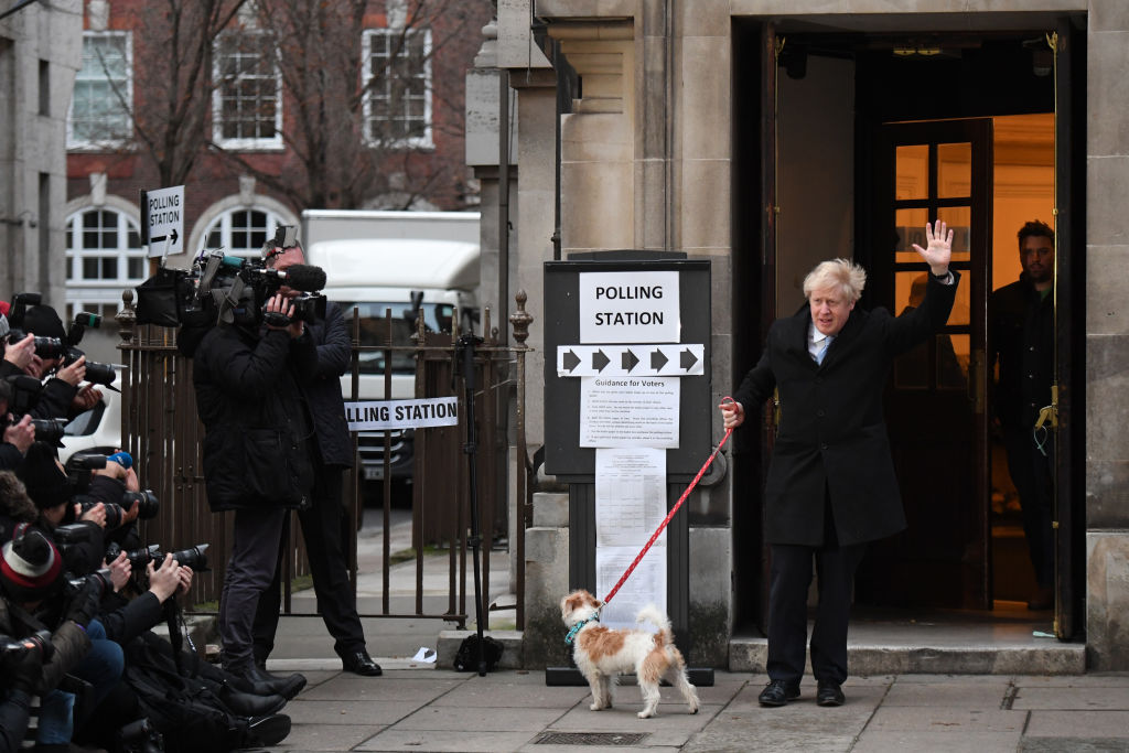 Prime minister Boris Johnson leaves after casting his vote with dog Dilyn at Methodist Hall polling station on December 12, 2019 in London, England.  (Photo by Chris J Ratcliffe/Getty Images)