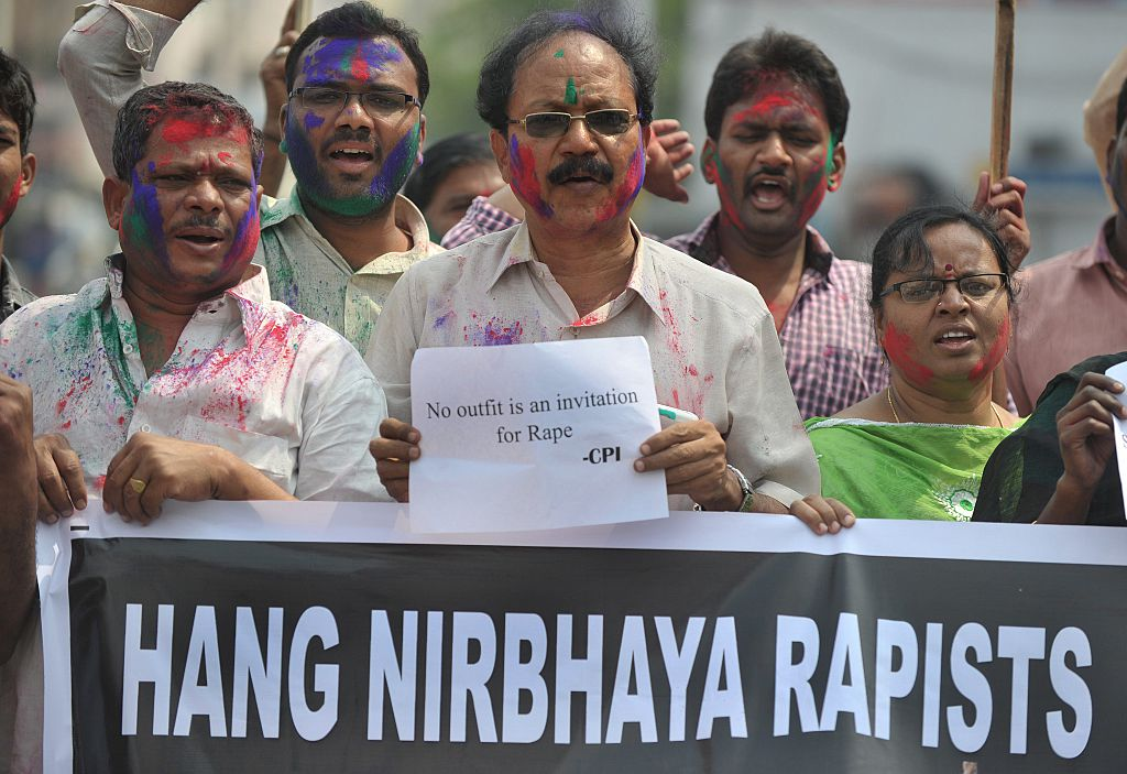 Activists hold placards during their protest against the rapists of Delhi student, Nirbhaya. (Photo: NOAH SEELAM/AFP via Getty Images)