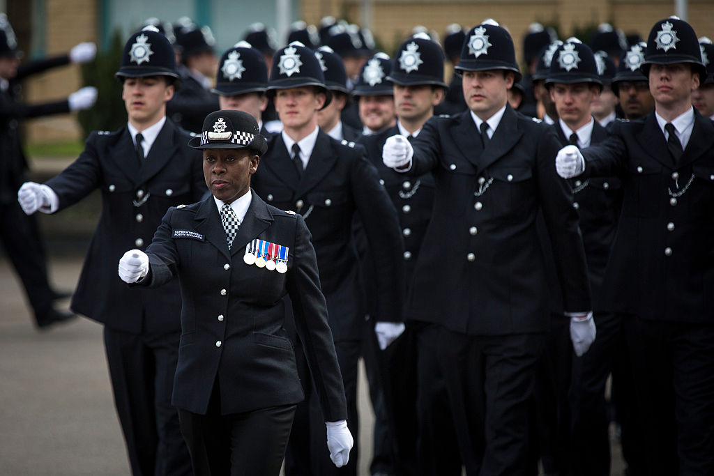 Robyn Williams leads new Met police recruits during their passing out parade in London.  (Photo by Rob Stothard/Getty Images)