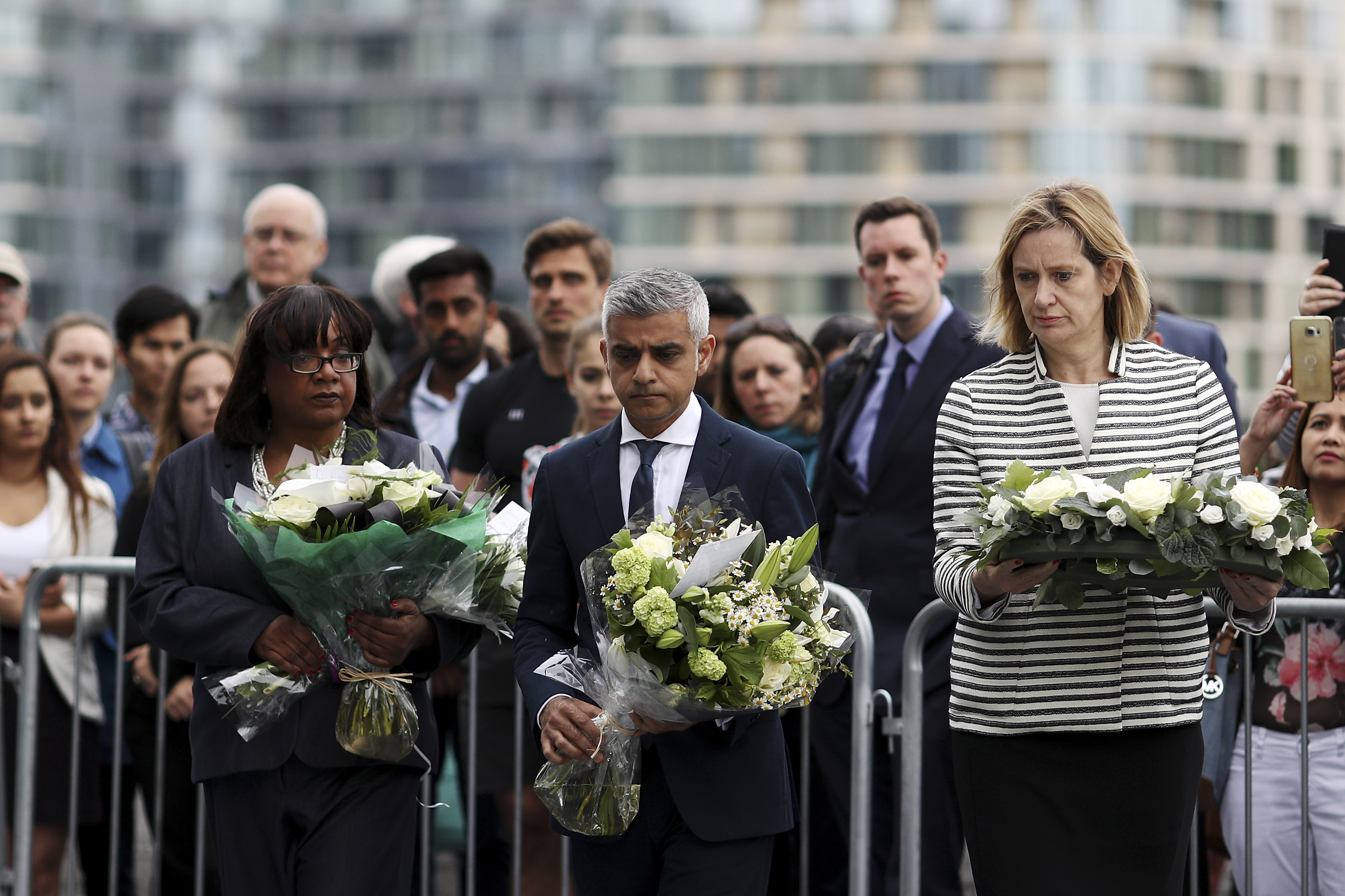 (L-R) Shadow Home Secretary Diane Abbott, Mayor of London Sadiq Khan and Home Secretary Amber Rudd take part in a vigil for the victims of the London Bridge terror attacks, in Potters Fields Park on June 5, 2017 in London.  (Photo by Dan Kitwood/Getty Images)