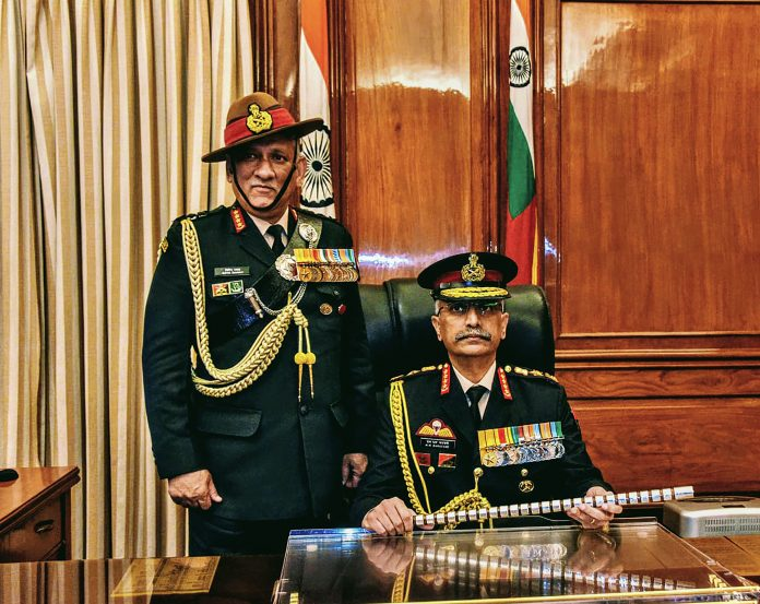 General Manoj Mukund Naravane takes charge as Chief of Army Staff in the presence of Chief of Defence Staff Gen Bipin Rawat in New Delhi, Tuesday (31) (PTI Photo).