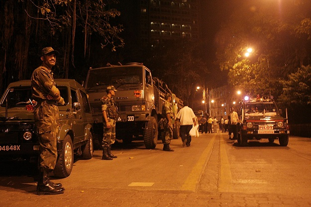 The military patrol outside the Taj Hotel on November 27, 2008 in Mumbai, India. The city of Mumbai was rocked by multiple coordinated terrorist attacks that targeted locations popular with foreigners, late on the night of November 26 and into the next morning, killing scores and wounding hundreds in shootings and blasts around the city (Photo: Ritam Banerjee/Getty Images).