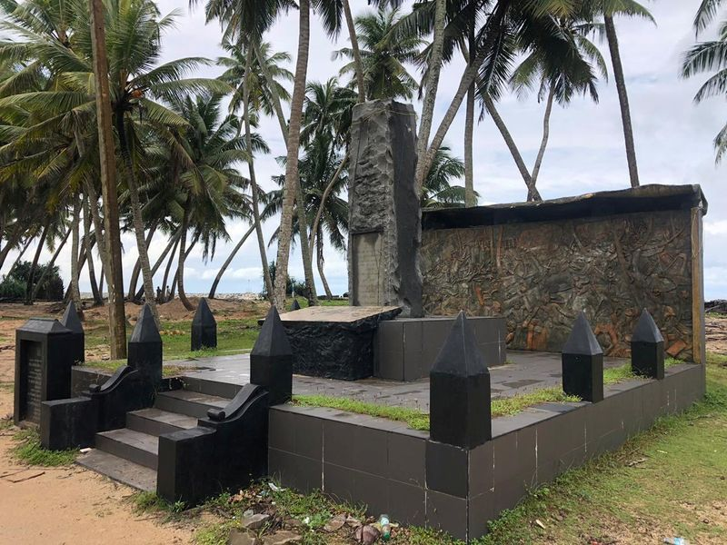 A memorial for those who died in the 2004 Boxing Day tsunami is seen near a tsunami-hit village, in Seenigama, Sri Lanka (Reuters)