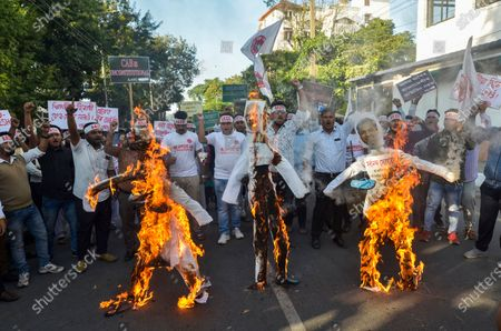 Activists of All Assam Students Union (AASU) burn effigies of Indian Prime Minister Narendra Modi, Indian Home Minister Amit Shah and Assam chief Minister Sarbananda Sonowal as they protest against the Citizenship Amendment Bill