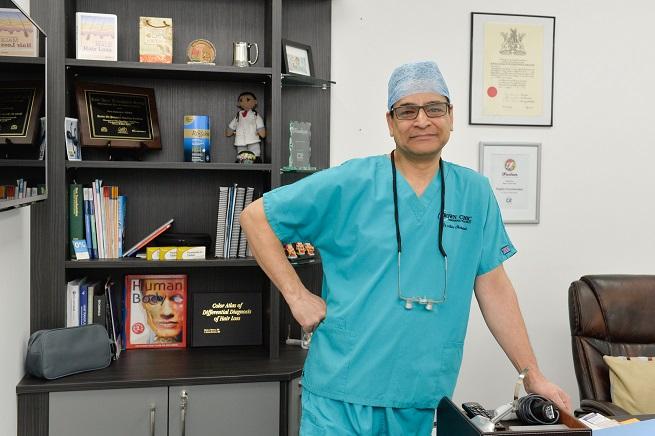 Dr Asim Shahmalak.